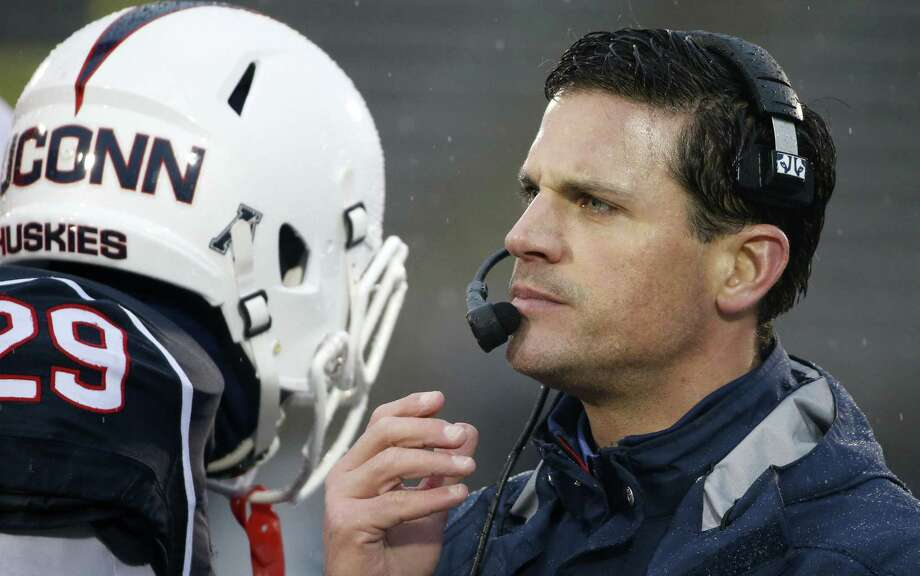 Connecticut head coach Bob Diaco leads his Huskies into tonight's season opener against Maine. (AP file photo) Photo: AP / AP