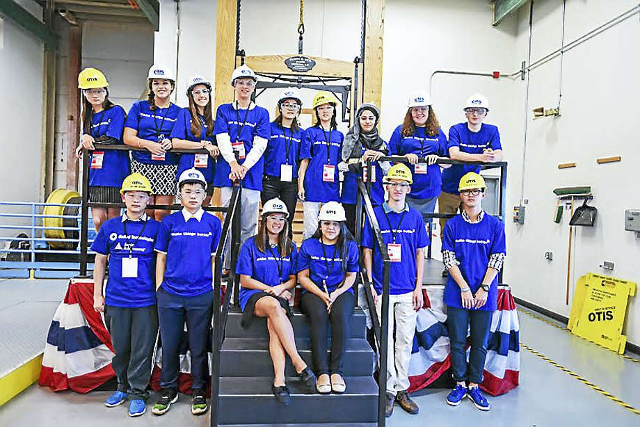 Wallingford high school students and students from China tour the Otis elevator company last year, when the studetns from China came to the U.S. for the Junior Achievement Global Connection program. Photo: CONTRIBUTED PHOTO