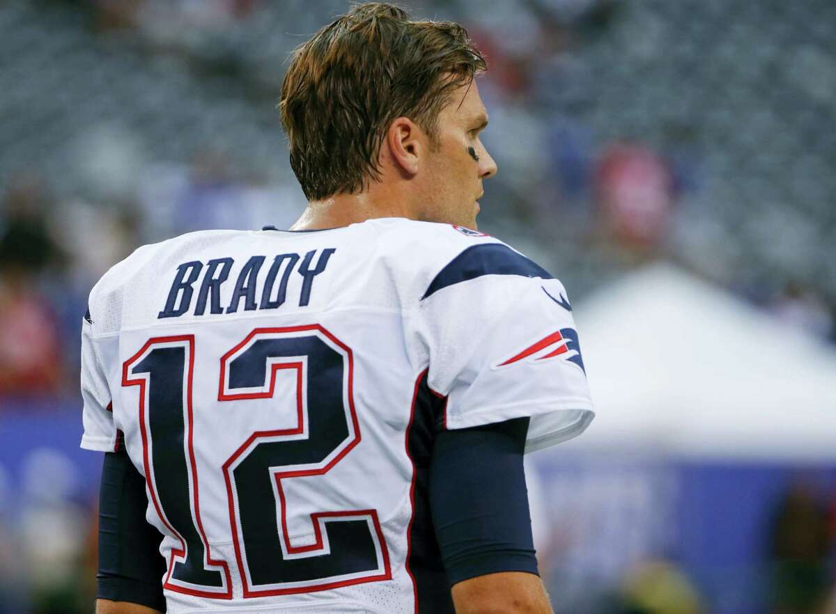 Patriots quarterback Tom Brady watches his team warm up before Thursday's game.