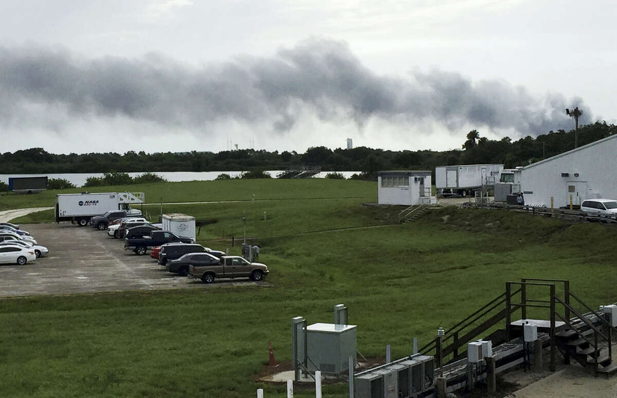 Smoke rises from a SpaceX launch site on Sept. 1, 2016 at Cape Canaveral, Fla. NASA said SpaceX was conducting a test firing of its unmanned rocket when a blast occurred.