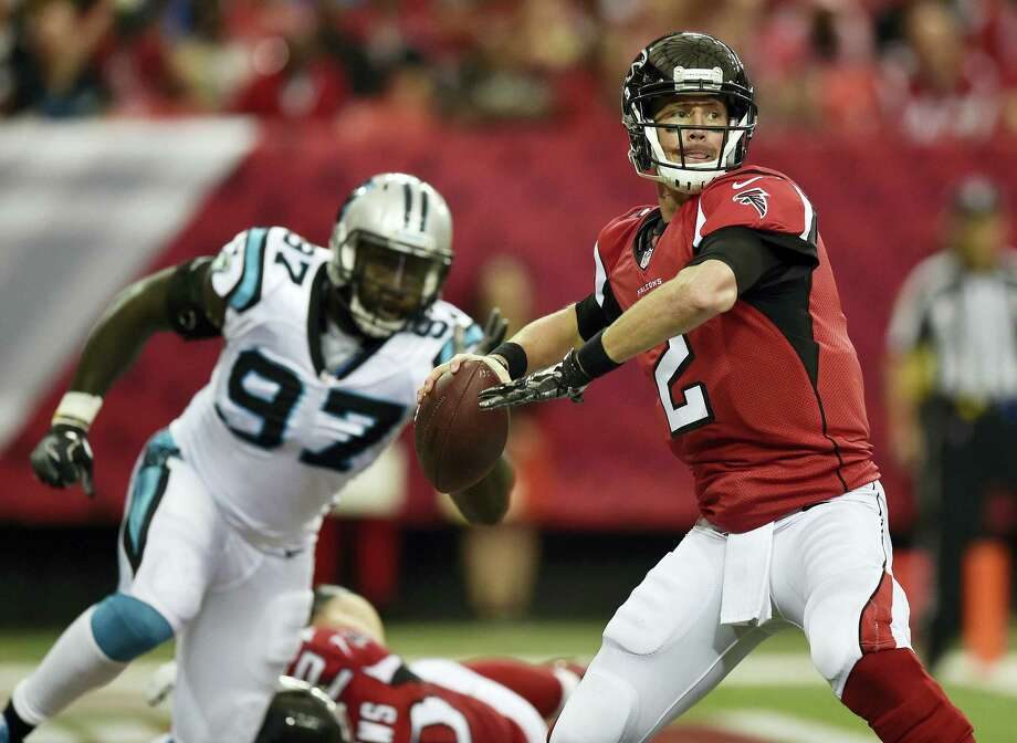 Atlanta Falcons quarterback Matt Ryan (2) works in the backfield as Carolina Panthers defensive end Mario Addison (97) defends during the first half of an NFL football game Sunday, Oct. 2, 2016 in Atlanta. Photo: AP Photo/Rainier Ehrhardt   / FR155191 AP