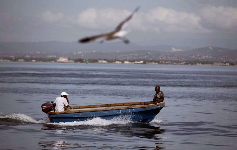 Fishermen sail on a boat at Port Royal in Kingston, Jamaica on Oct. 2, 2016. Hurricane Mathew, one of the most powerful Atlantic hurricanes in recent history weakened a little on Saturday as it drenched coastal Colombia and roared across the Caribbean on a course that threatened Jamaica, Haiti and Cuba. Photo: AP Photo/Eduardo Verdugo   / Copyright 2016 The Associated Press. All rights reserved.