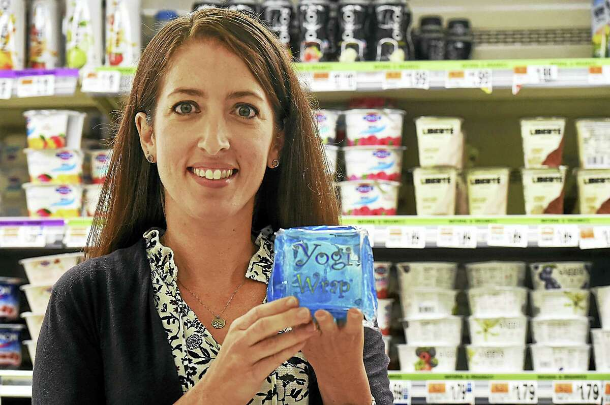 Fourth grade teacher and mother of two Teri Alves, of Orange is photographed in a local grocery store with her invention, the Yogi Wrap. Alves, a teacher who survived the Sandy Hook shooting, used her experience as post-traumatic growth to invent the lunchbox-sized yogurt ice pack.