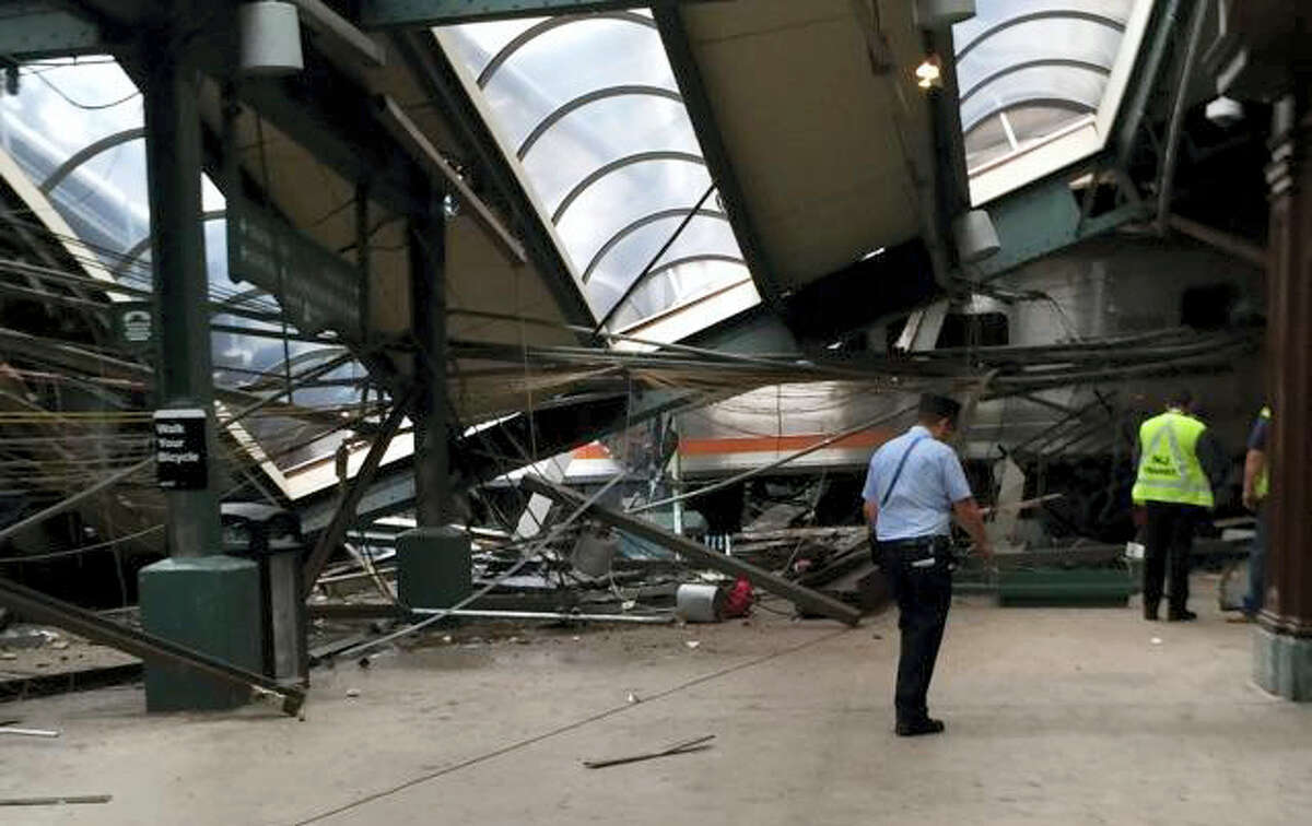 This Thursday, Sept. 29, 2016 photo provided by a passenger who was on the train when it crashed shows wreckage at the Hoboken, N.J. rail station. The commuter train barreled into the station during the morning rush hour, coming to a halt in a covered area between the station's indoor waiting area and the platform.