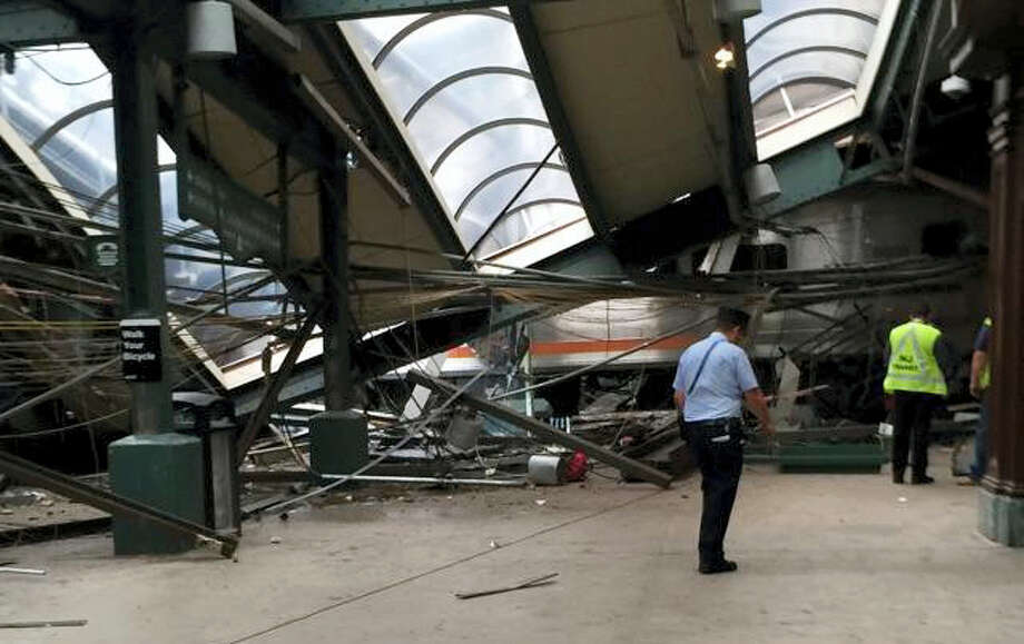 This Thursday, Sept. 29, 2016 photo provided by a passenger who was on the train when it crashed shows wreckage at the Hoboken, N.J. rail station. The commuter train barreled into the station during the morning rush hour, coming to a halt in a covered area between the station's indoor waiting area and the platform. Photo: AP Photo   / Copyright 2016 The Associated Press. All rights reserved.