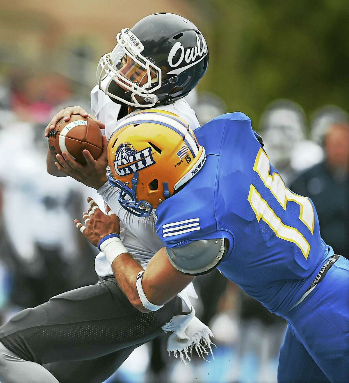 New Haven's Stefano Bicknese tackles SCSU's Raymond Catapano during Saturday's game.