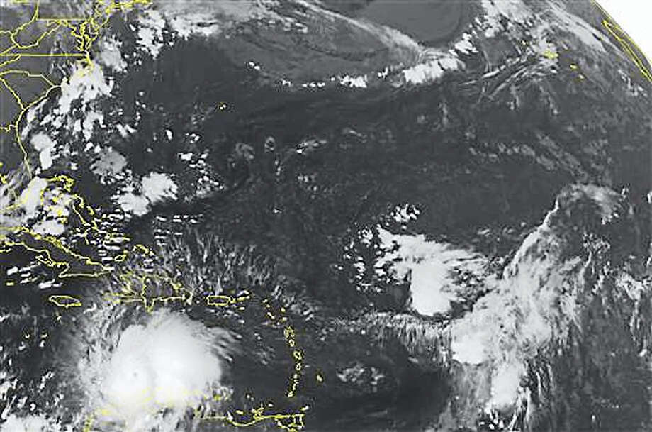 This NOAA satellite image taken Saturday, Oct. 1, 2016, at 12:45 AM EDT shows well defined Hurricane Matthew continuing to slowly move westward at about 7 MPH across the Caribbean. Recent reconnaissance missions have revealed max sustained wind speeds up to 160 MPH, bringing Matthew up to a category 5 hurricane. Some of the outer bands can be seen pushing into Hispaniola, as well as Venezuela and Columbia. Matthew is expected to begin its northward turn over the next few days, largely impacting Jamaica next. Photo: NOAA/Weather Underground Via AP    / NOAA/Weather Underground via AP