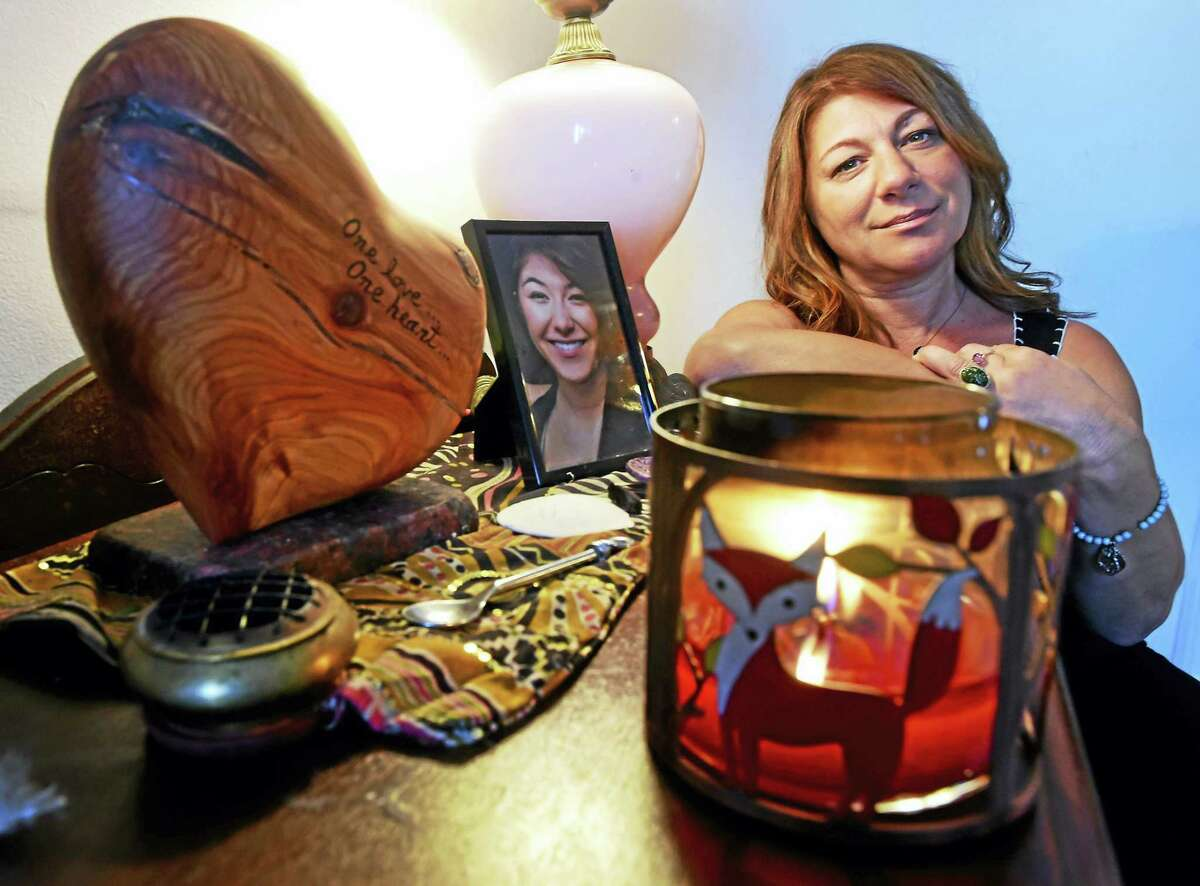 Donna Cimarelli of Milford, the mother of murdered Maren Sanchez, at home Thursday, Sept. 29, 2016 next to a small memorial for her daughter in her living room that includes a heart shaped urn that holds Maren's ashes, far left. Maren Sanchez was killed by a high school classmate in April 2014. Cimarelli is staring a new foundation that educates girls on recognizing and defeating attempts at emotional and psychological manipulation and control. The education will include lessons on physical self-defense.