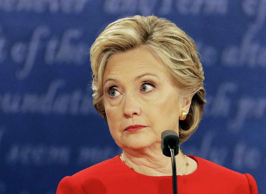 Democratic presidential nominee Hillary Clinton listens to Republican presidential nominee Donald Trump during the presidential debate at Hofstra University in Hempstead, N.Y., Monday, Sept. 26, 2016. Photo: Julio Cortez  — AP Photo / Copyright 2016 The Associated Press. All rights reserved.