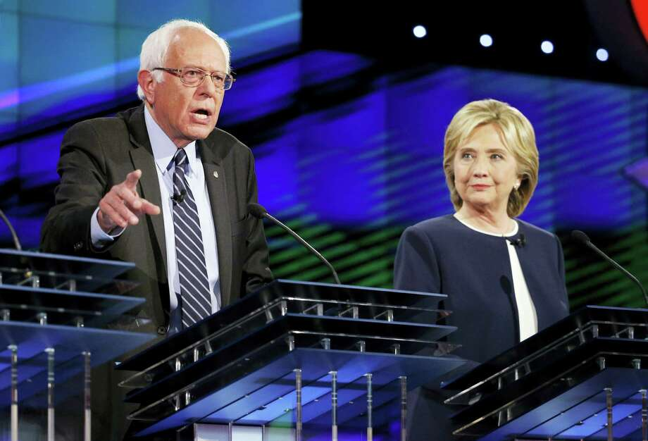 Hillary Rodham Clinton, right, looks on as Sen. Bernie Sanders, of Vermont, speaks during the CNN Democratic presidential debate Tuesday, Oct. 13, 2015, in Las Vegas. Photo: AP Photo — John Locher / AP