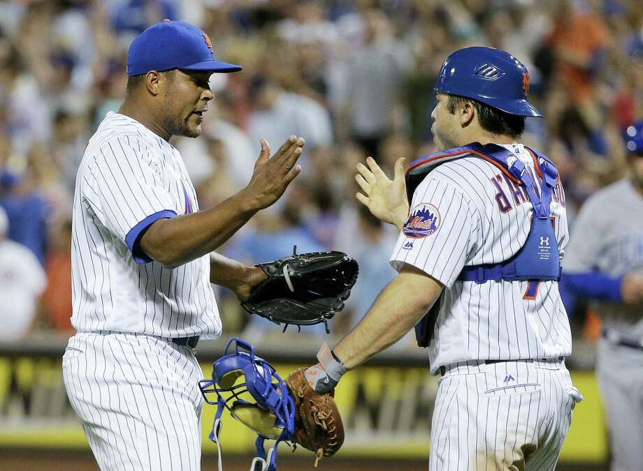 Mets relief pitcher Jeurys Familia, left, celebrates with catcher Travis d'Arnaud after the Mets beat the Cubs on Thursday. Photo: Julie Jacobson — The Associated Press   / Copyright 2016 The Associated Press. All rights reserved. This material may not be published, broadcast, rewritten or redistribu