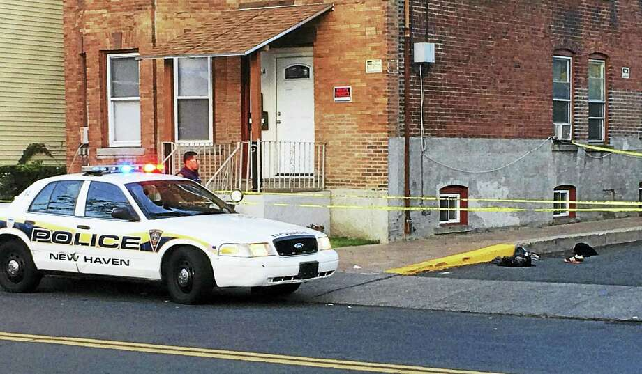 Police were investigating after two people were hurt in an assault early Thursday in New Haven's Fair Haven neighborhood. One of the victims was shot in the arm, police confirmed at the scene. Photo: Wes Duplantier/The New Haven Register