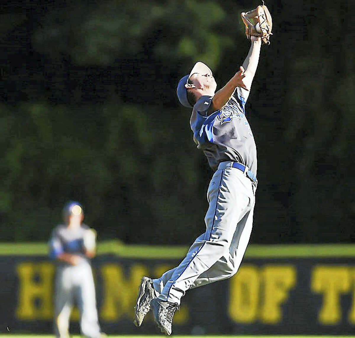 East Haddam second baseman Zach Johnson makes a spectacular catch against Madison in a 6-2 win for Post 156, Wednesday, June 29, 2016, at Polson in Madison.