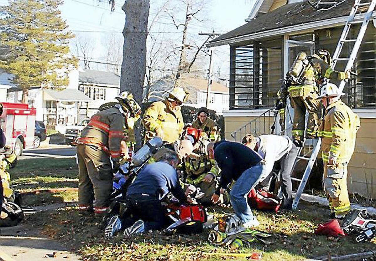 East Haven firefighters rescue a man who was found unconcious in his burning home in January.