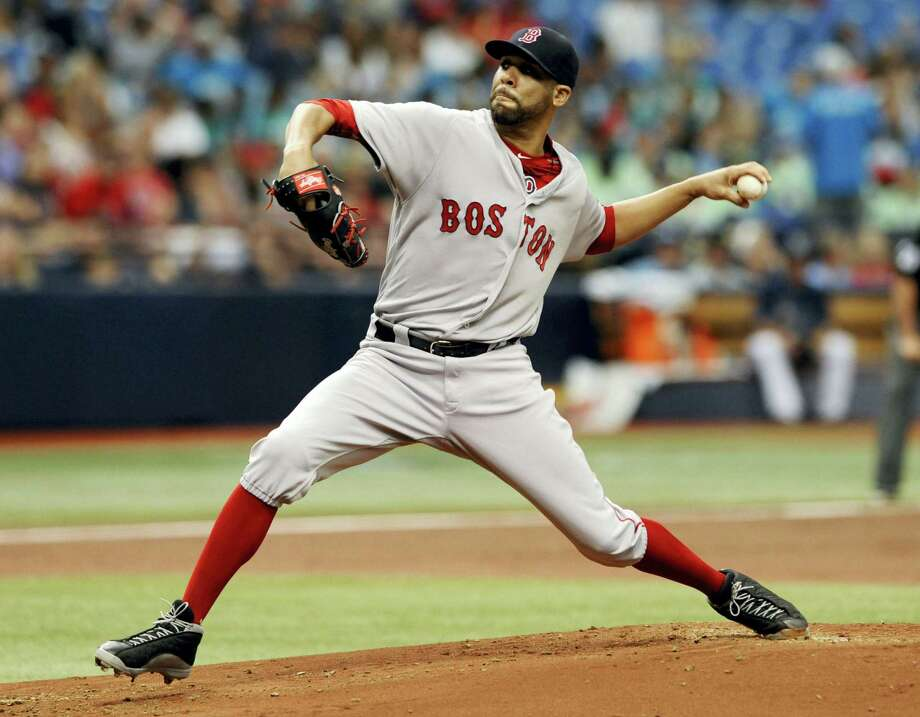 Boston Red Sox starter David Price pitches against the Tampa Bay Rays in the first inning on Wednesday in St. Petersburg, Fla. The Rays shut out the Red Sox 4-0. Photo: Steve Nesius — The Associated Press   / FR69810 AP