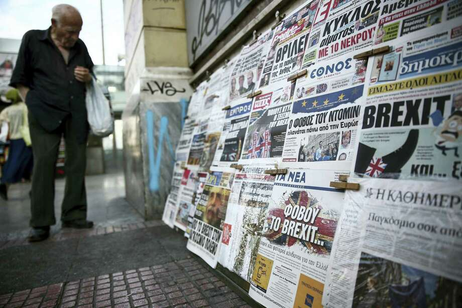 A man browses through newspapers outside a kiosk in Athens on June 25, 2016. Photo: AP Photo/Yorgos Karahalis   / Copyright 2016 The Associated Press. All rights reserved. This material may not be published, broadcast, rewritten or redistribu