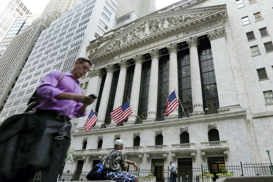 In this Friday, June 24, 2016, file photo, a man walks by the New York Stock Exchange. U.S. stock indexes were solidly higher in early trading Tuesday, June 28, 2016, as investors welcomed encouraging data on the economy and housing. The rebound followed even bigger gains in Europe as global markets recovered from a two-day rout triggered by Britain's vote to leave the European Union. Photo: AP Photo/Richard Drew, File    / Copyright 2016 The Associated Press. All rights reserved. This material may not be published, broadcast, rewritten or redistribu