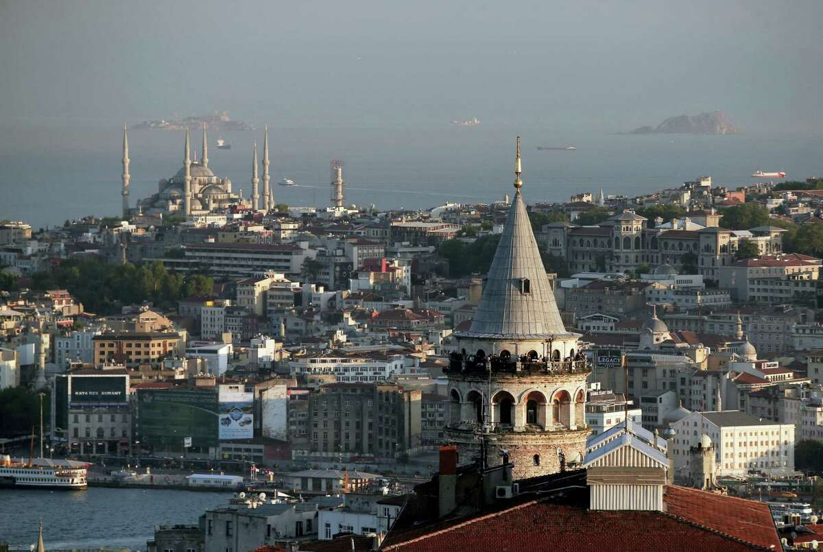 This May 6, 2016 photo shows a view of Istanbul's skyline with the iconic Galata Tower and the Ottoman-era Sultan Ahmed Mosque, background left, better known as the Blue Mosque.