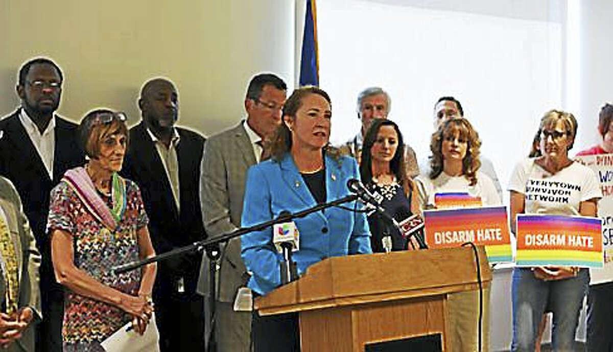 Democratic U.S. Reps. Elizabeth Esty and Rosa DeLauro with Democratic Gov. Dannel P. Malloy.