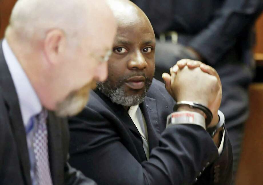 Defendant Shawn Custis, right, sits in court with his attorney John McMahon before he was sentenced to life plus 5 years by Superior Court Judge Ronald Wigler Wednesday, June 29, 2016, in Newark, N.J. Earlier Custis was found guilty in the brutal beating of a woman during a 2013 home invasion caught on a nanny-cam home security video. Photo: Robert Sciarrino — NJ Advance Media Via AP, Pool / Pool NJ Advance Media