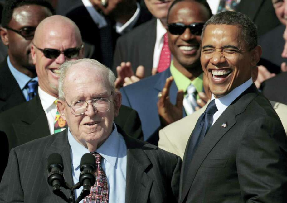 In this Oct. 7, 2011, file photo, President Barack Obama, right, smiles at former defensive coordinator Buddy Ryan, speaking left, as he stands with the 1985 Super Bowl XX Champions Chicago Bears football team during a ceremony on the South Lawn of the White House in Washington. Buddy Ryan, who coached two defenses that won Super Bowl titles and whose twin sons Rex and Rob have been successful NFL coaches, died Tuesday, June 28, 2016. He was 82. Photo: AP Photo/Pablo Martinez Monsivais, File    / AP2011