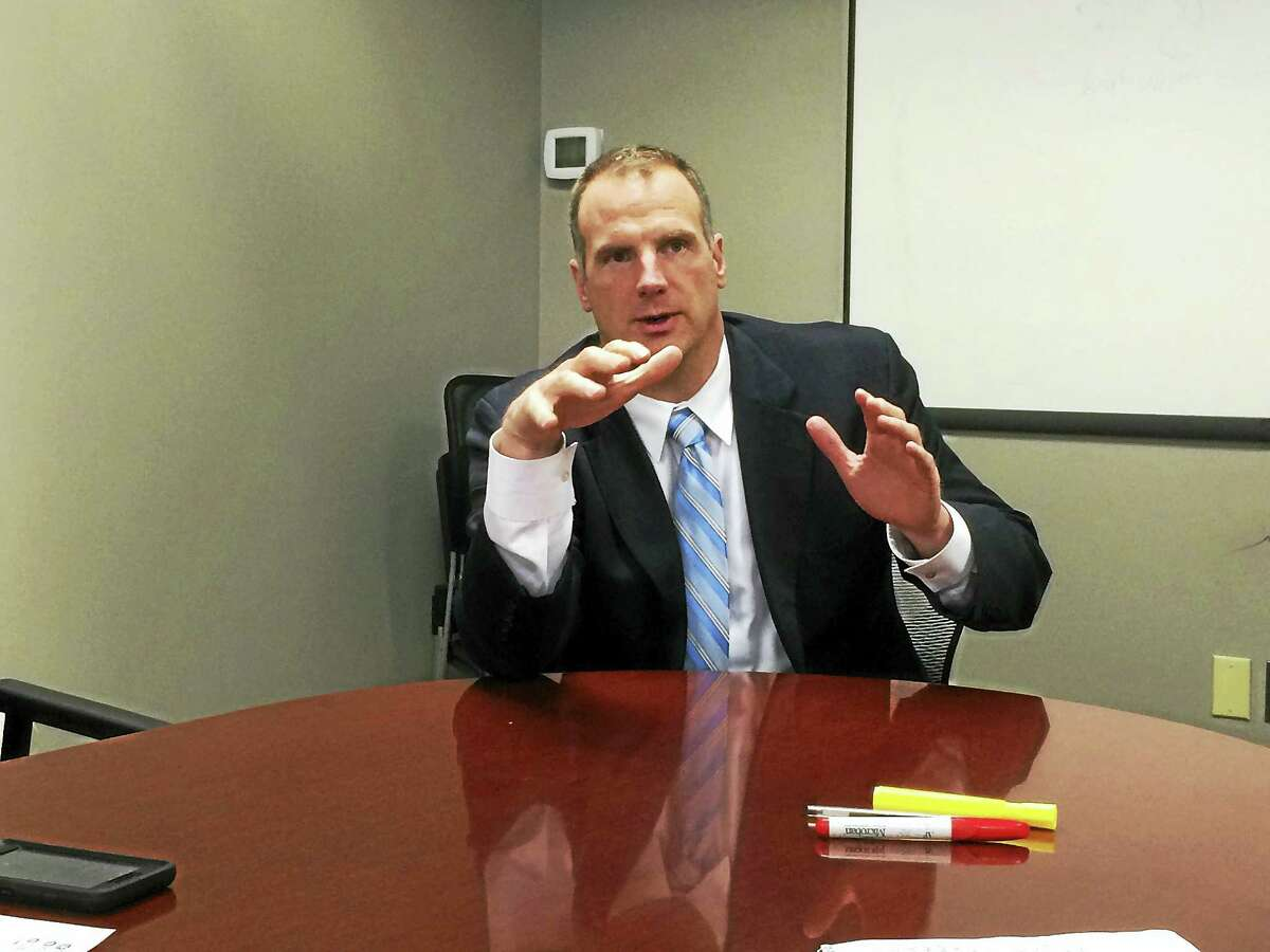 Joe Delong, executive director of the Connecticut Conference of Municipalities, is seen during a recent editorial board meeting with Digital First Media staff.
