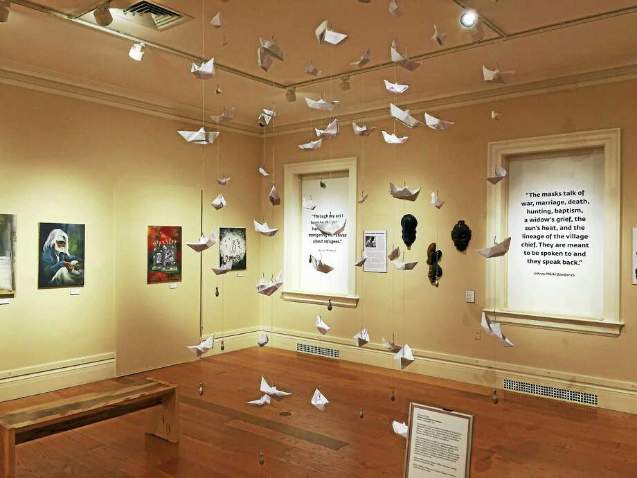 "The hanging exhibit ""Mother, I Don't Know How to Swim,"" designed by architect Mohamad Hafez. Photo: Joe Amarante — Register"