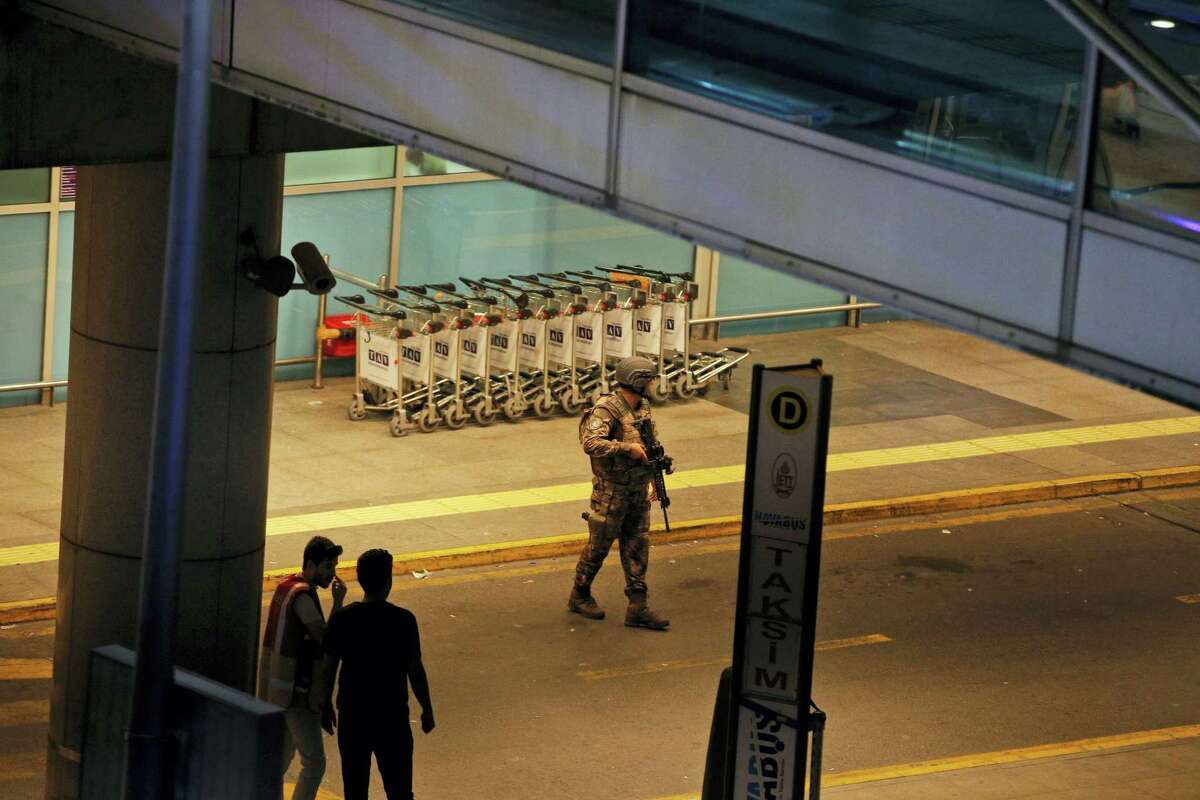Turkish security officers gather outside Istanbul's Ataturk airport, Tuesday, June 28, 2016. Two explosions have rocked Istanbul's Ataturk airport, killing several people and wounding scores of others, Turkey's justice minister and another official said Tuesday. A Turkish official says two attackers have blown themselves up at the airport after police fire at them. The official said the attackers detonated the explosives at the entrance of the international terminal before entering the x-ray security check.