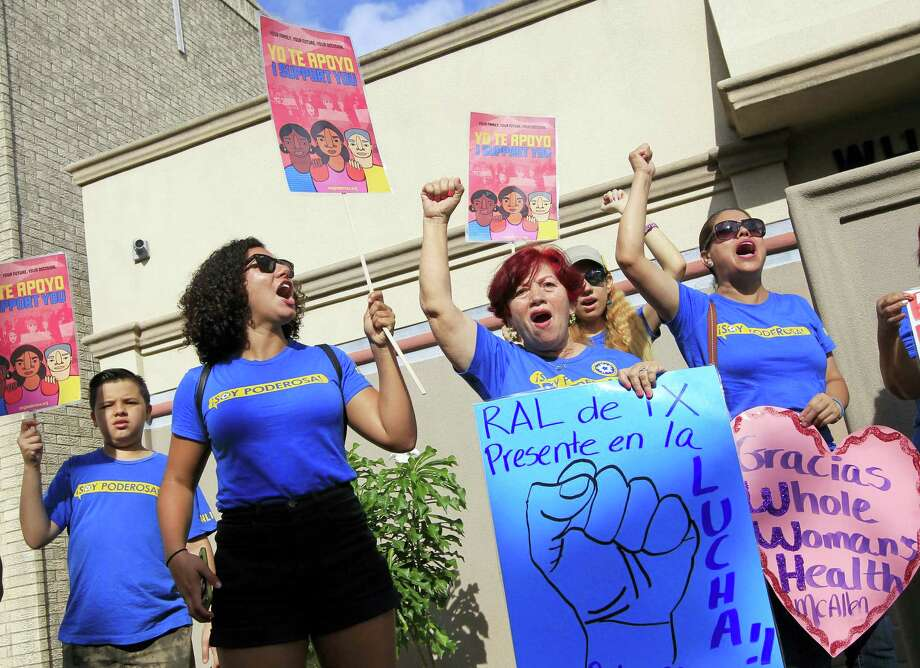 Lucy Ceballos, center, and Isabella Soto, left, members of the National Institute for Reproductive Health, celebrate the U.S. Supreme Court ruling against Texas' abortion restrictions in front of Whole Woman's Health Monday in McAllen, Texas. Photo: Nathan Lambrecht — The Monitor Via AP   / The Monitor