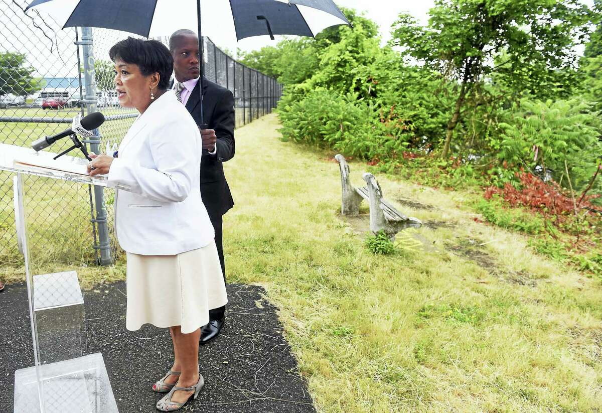 New Haven Mayor Toni Harp Tuesday announces funding of $288,351 from the Connecticut Department of Energy and Environmental Protection, which will be used for improvements to the Mill River Trail behind her at right.