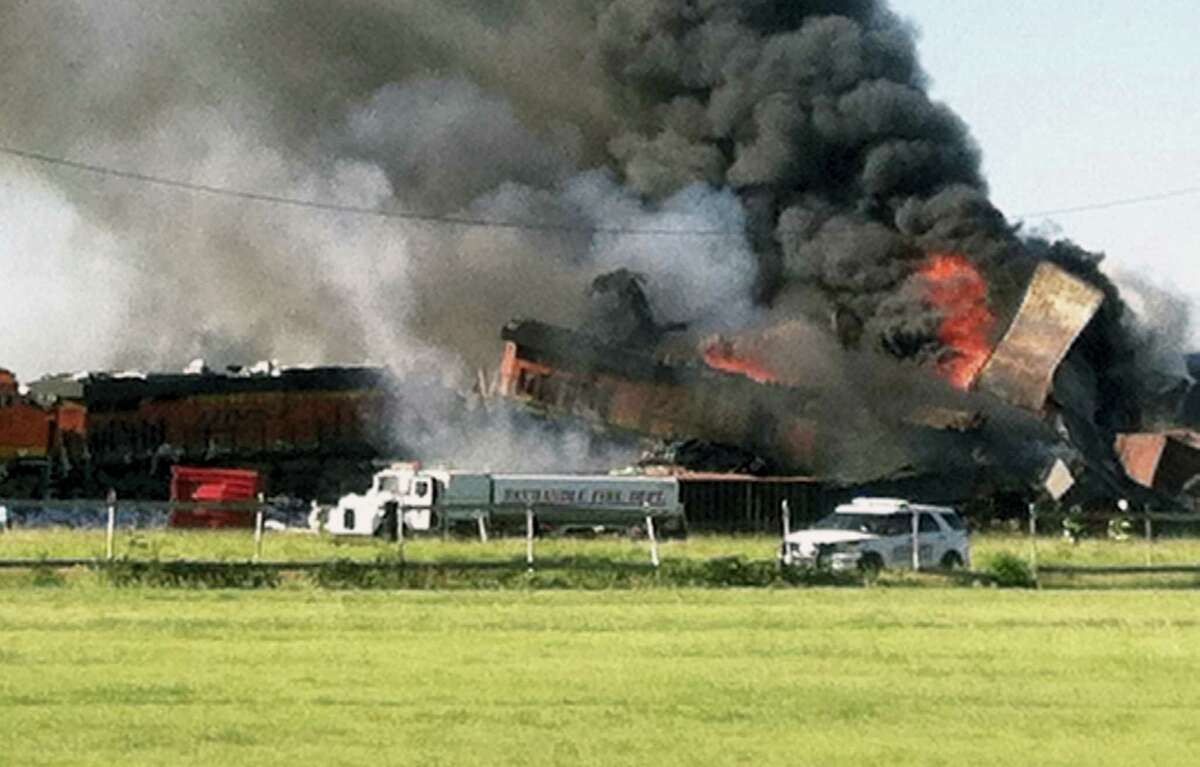 In this photo provided by Billy B. Brown, two freight trains are on fire Tuesday, June 28, 2016, after they collided and derailed near Panhandle, Texas. Texas Department of Public Safety Lt. Bryan Witt says the accident occurred Tuesday morning near the town of Panhandle, about 25 miles northeast of Amarillo. No injuries have been reported.