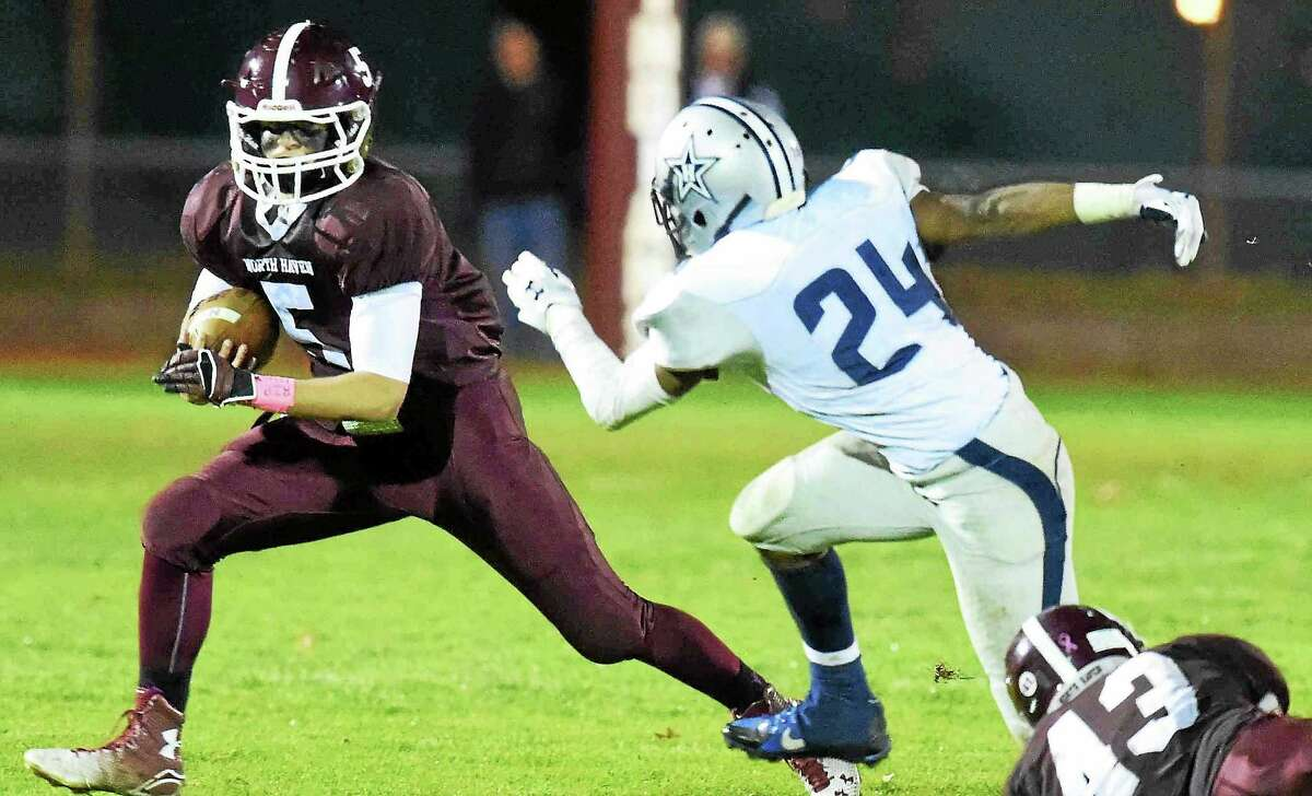 Peter Hvizdak - Register ¬ North Haven's Mike Montano breaks to the outside in the Indians win over Hillhouse.