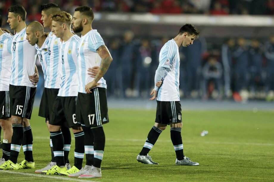 Argentina's Lionel Messi, right, reacts after Argentina's Gonzalo Higuain, missed his penalty kick against Chile during the 2015 Copa America final soccer match in Santiago, Chile. Photo: The Associated Press File Photo   / Copyright 2016 The Associated Press. All rights reserved. This material may not be published, broadcast, rewritten or redistribu