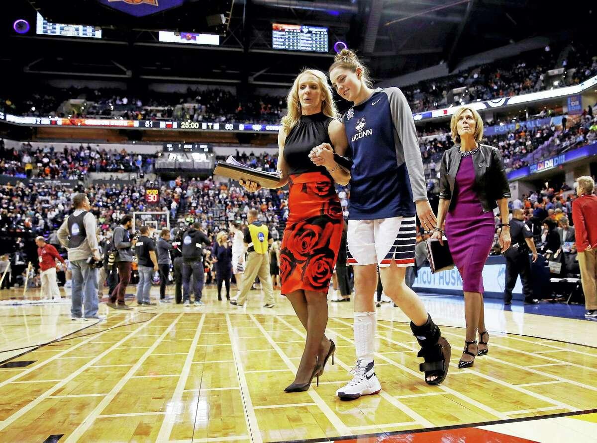 UConn's Katie Lou Samuelson (33) leaves the court with assistant coach Shea Ralph last April.