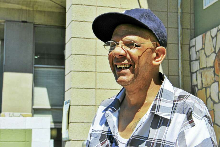Humberto Jimenez outside Multicultural Ambulatory Addictions Services on East Street in New Haven on June 15. Jimenez receives treatment for heroin addiction at the center, which recently partnered with another local health care center to provide more resources to low-income people.   Correction: This story has been updated to indicate that Olson said an uninsured patient buying medication like buprenorphine could pay $600 a month out of pocket. Photo: Esteban L. Hernandez — New Haven Register