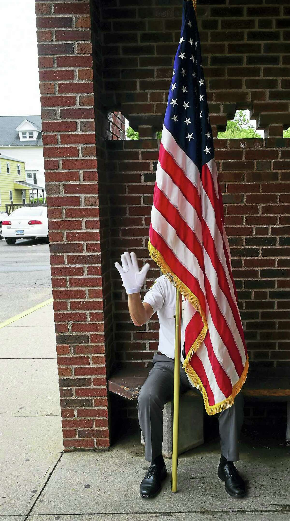American Legion Post 89 of East Haven honor guard member Carl Ioveino of East Haven, a U.S. Navy veteran, holds Old Glory Monday before the start of a Memorial Day ceremony at the East Haven Senior Center.