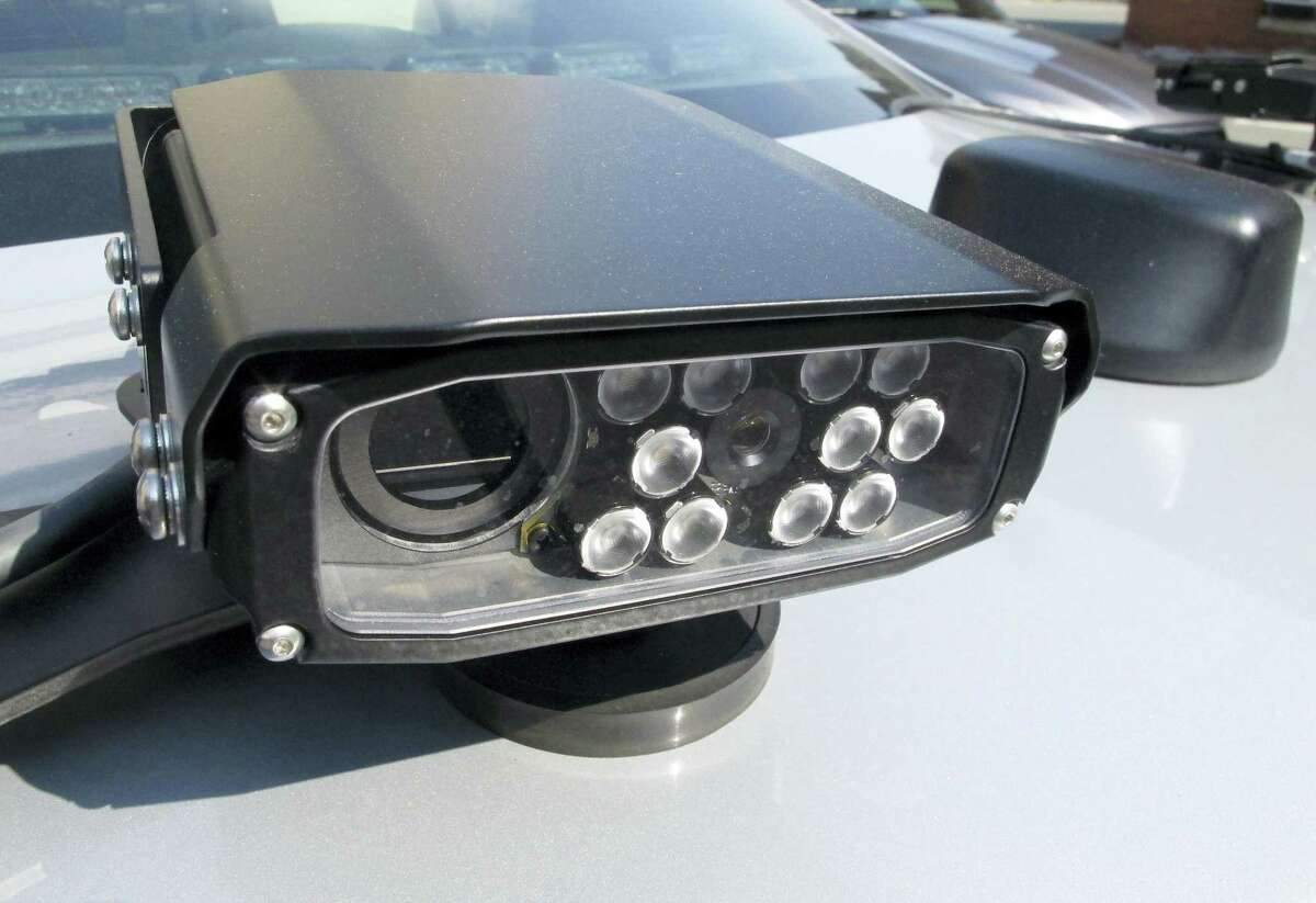 In this May 27, 2016 photo, a license plate reading camera is mounted on the back of a Connecticut State Police cruiser in Hartford, Conn. The license plate readers resulted in nearly 6,800 traffic stops statewide last year, up from about 1,600 in 2014.