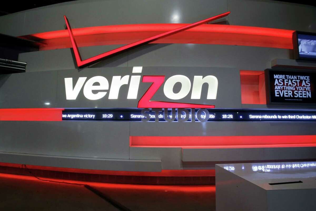 This April 7, 2013, file photo shows the Verizon studio booth at MetLife Stadium, in East Rutherford, N.J. Nearly 40,000 striking Verizon employees will return to work Wednesday, June 1, 2016, after reaching a tentative contract agreement that includes 1,300 new call center jobs, nearly 11 percent in raises over four years and the first contract for Verizon wireless store workers, a union said Monday.