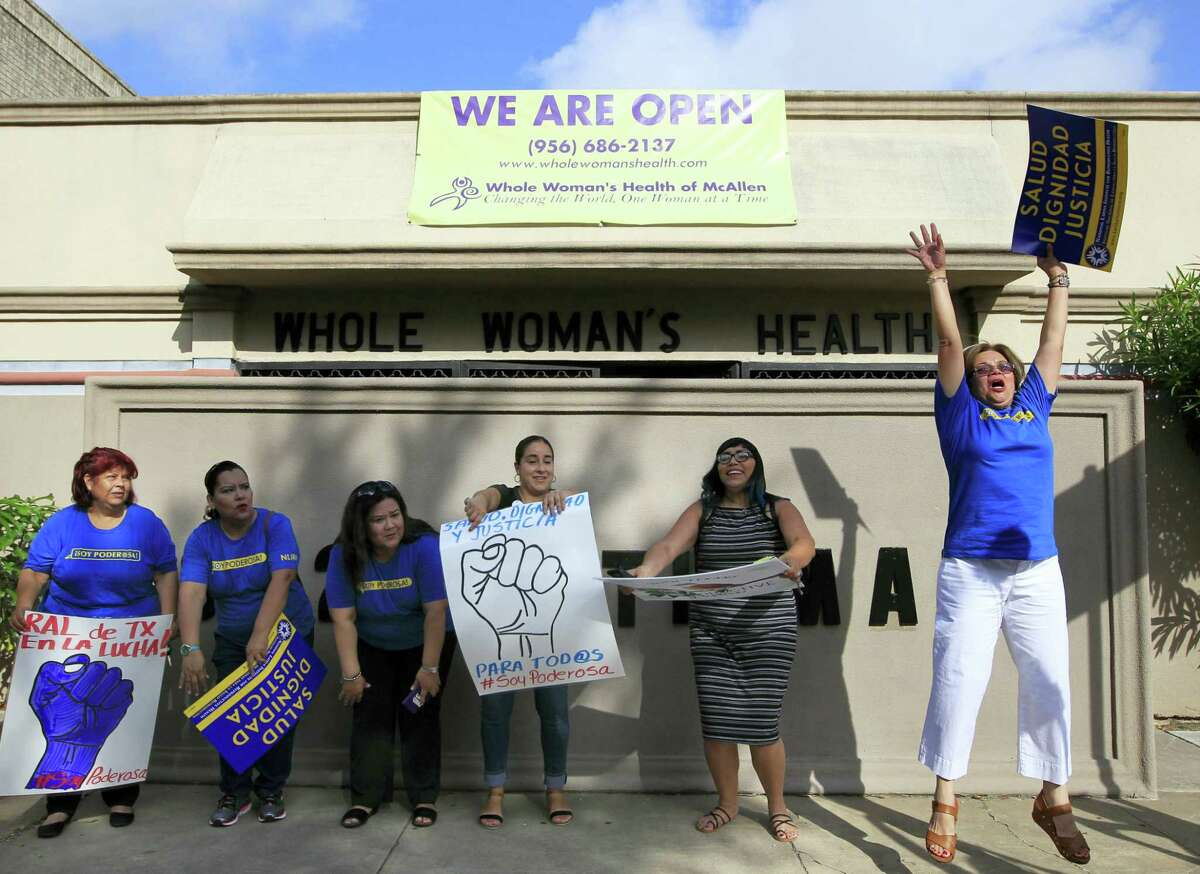 Lucy Felix, right, jumps for joy as other members of the National Institute for Reproductive Health celebrate the U.S. Supreme Court ruling against Texas' abortion restrictions in front of Whole Woman's Health Monday June 27, 2016 in McAllen, Texas. Whole Woman's Health is a abortion provider that stayed open despite the restrictions as many other providers closed over the past two years. (Nathan Lambrecht/The Monitor via AP)