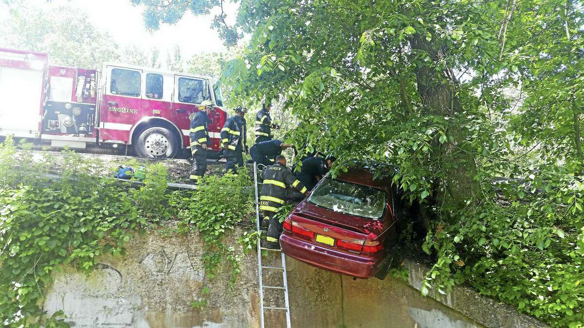 Part of Route 15 was shut down and fire crews had to extricate two people from a crashed car after an accident early Tuesday afternoon in Hamden.