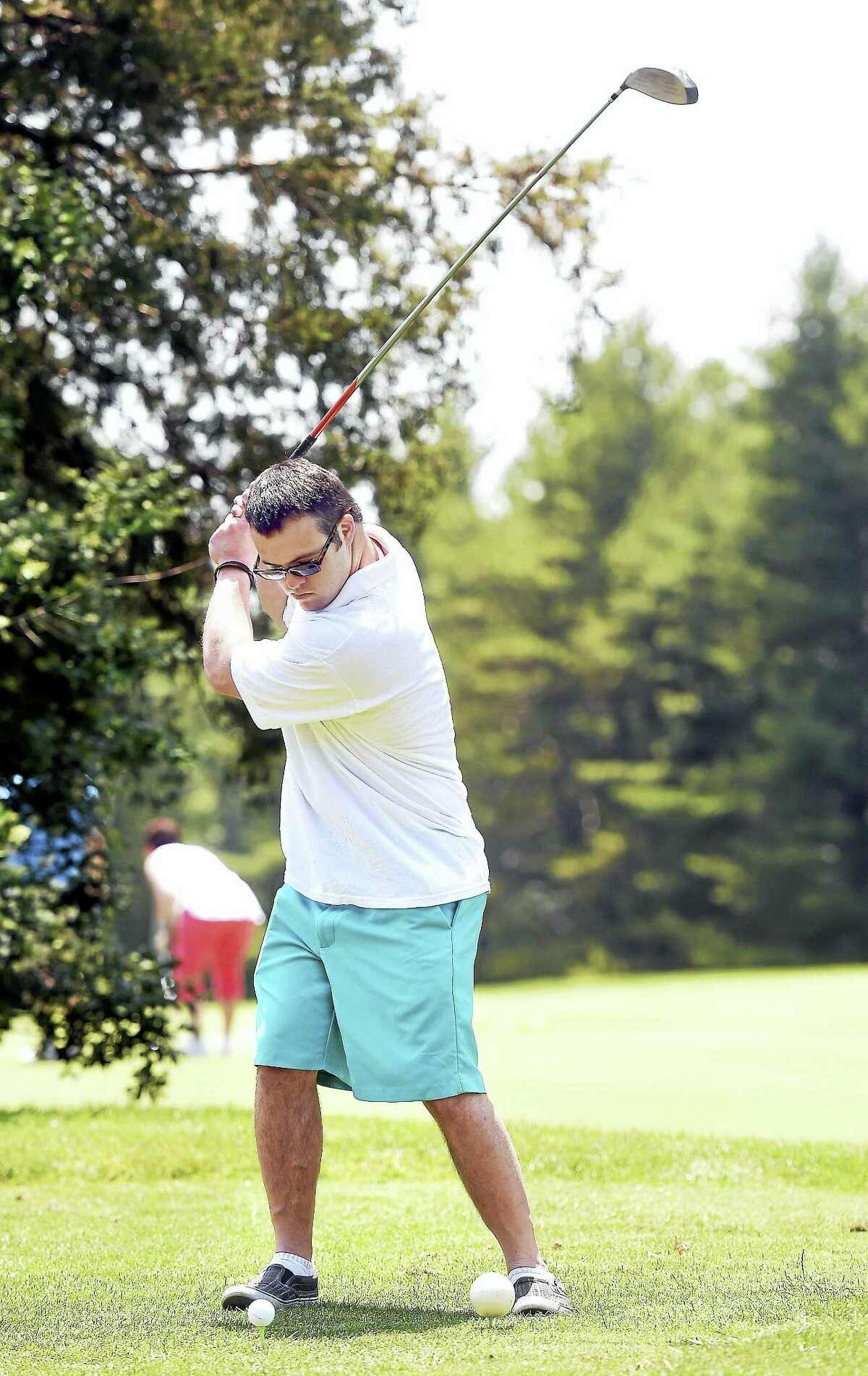 Sean Bogart of Hamden hits for Roy Garofalo on the third hole of the Mia Joseph Golf Tournament at the Country Club of Woodbridge Sunday.