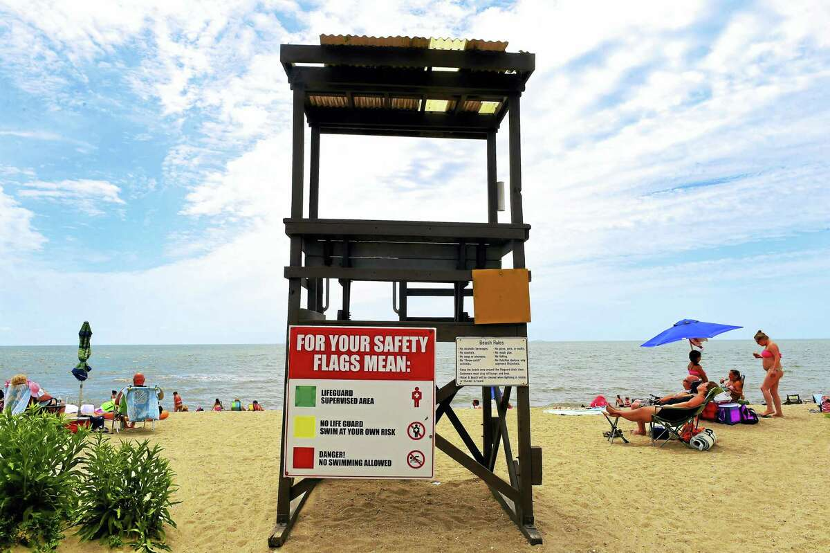 An empty lifeguard stand on East Beach at Hammonasset Beach State Park in Madison Monday.