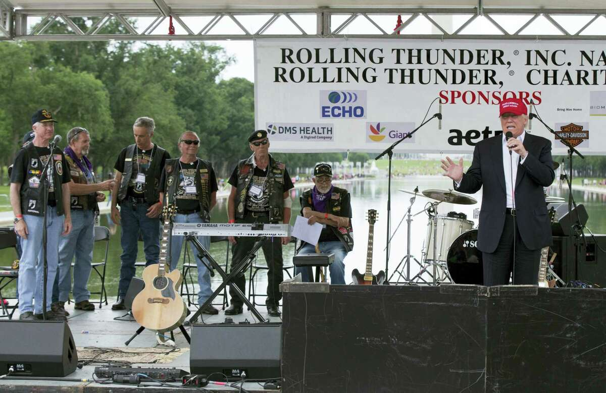 Republican presidential candidate Donald Trump, right, speaks to supporters and bikers at a Rolling Thunder rally at the National Mall in Washington on Sunday.