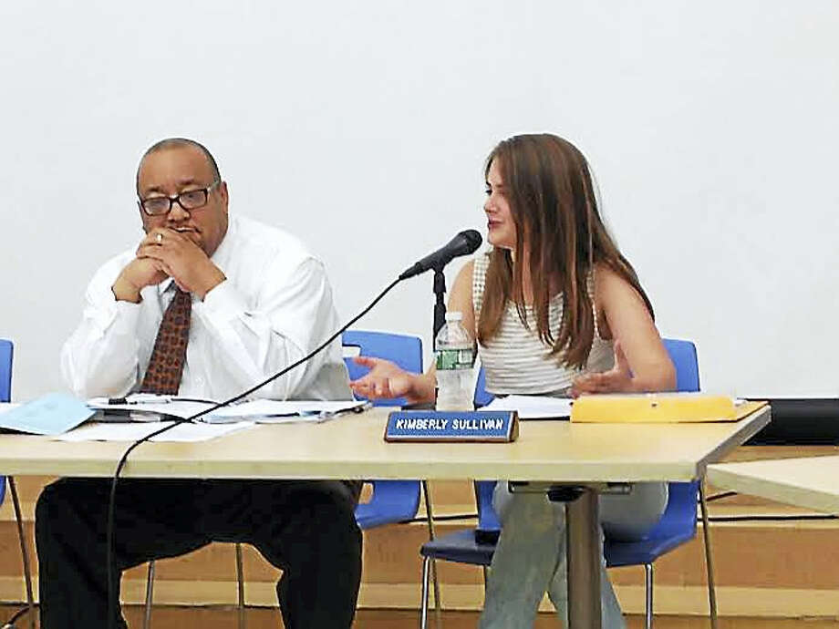 Kimberly Sullivan, student board of education member, delivers her final student report. At left is board member Darnell Goldson. Photo: Brian Zahn — New Haven Register
