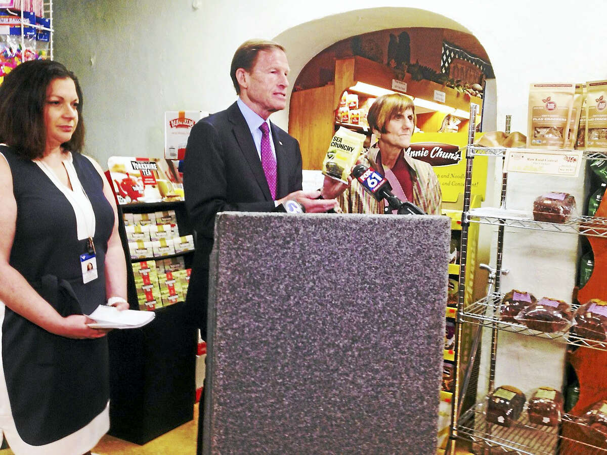 """From left, dietitian Ilisa Nussbaum, U.S. Sen. Richard Blumenthal and U. S. Rep. Rosa DeLauro talk about food labeling at Edge of the Woods and the need for the FDA to define the word """"natural."""" They praised Edge of the Woods for vetting natural products."""