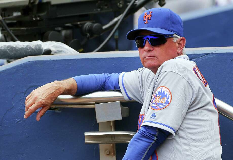 Mets manager Terry Collins looks on from the dugout on Sunday. Photo: John Bazemore — The Associated Press   / AP