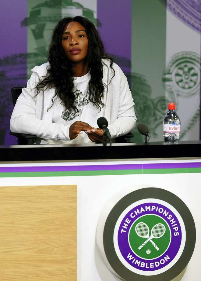 Serena Williams answers questions at a press conference at The All England Lawn Tennis Club on Sunday. Photo: Florian Eisele — Pool Photo Via AP   / AELTC POOL