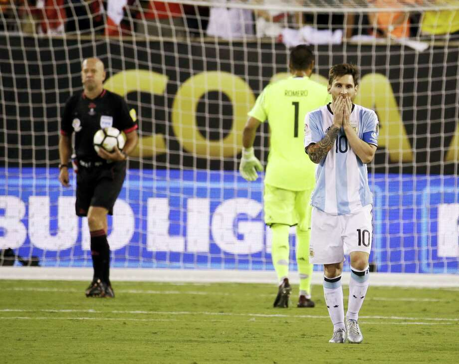 Argentina's Lionel Messi reacts after missing his shot during penalty kicks. Photo: Julio Cortez — The Associated Press   / Copyright 2016 The Associated Press. All rights reserved. This material may not be published, broadcast, rewritten or redistribu