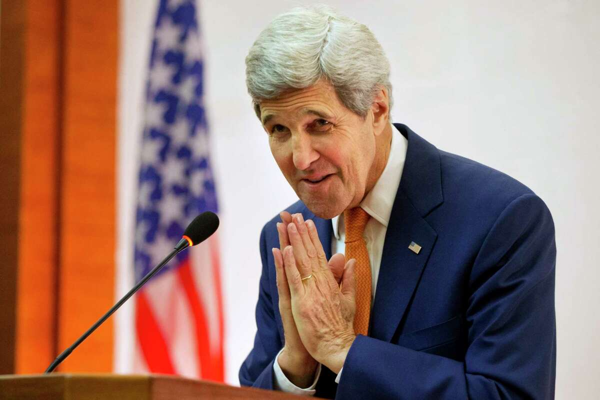 U.S. Secretary of State John Kerry greets U.S. Embassy staff in Vientiane, Laos on Jan. 25, 2016.