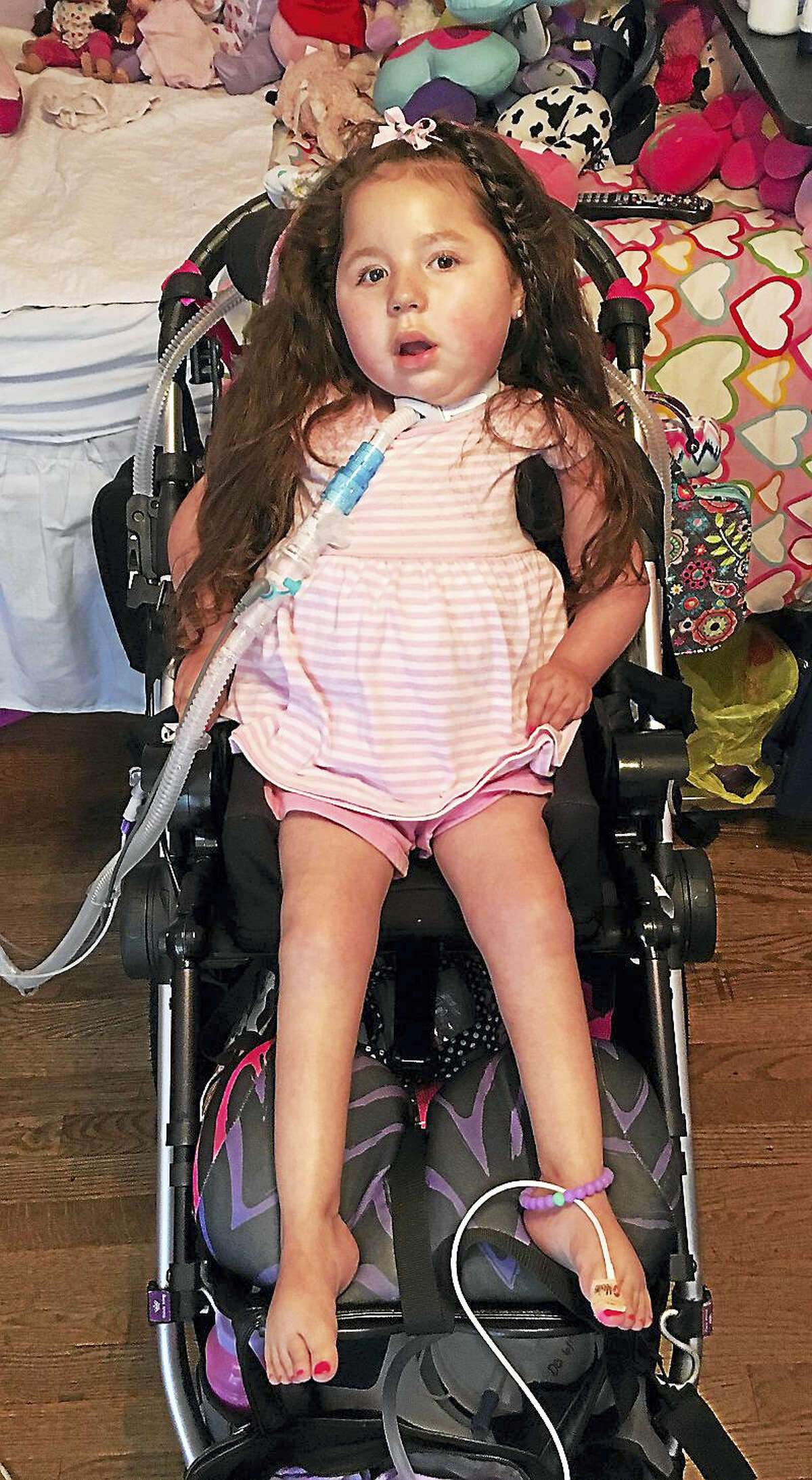 (Contributed Photo) Eva Grace Kelly, 5, of West Haven, has a rare condition that causes her muscles to stop working and is beginning to block her ability to smile.